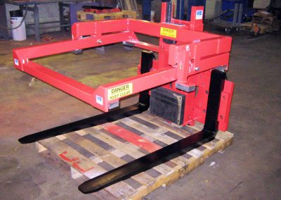 Carriage mounted, revolving bin handling frame