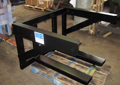 Fixed, fork mounted bin handling frame