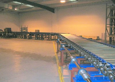 Heavy duty chain driven 'S' shape roller conveyor with bends