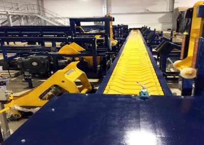 Reversible slat conveyor